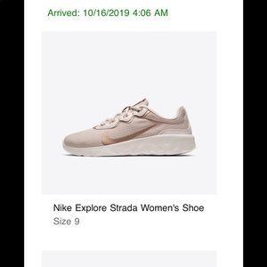 Women's size 9 rose gold Nike sneakers
